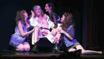 """Kyle Szen as Stacee Jaxx is surrounded by women in a scene from """"Rock of Ages"""" at the Eldorado."""