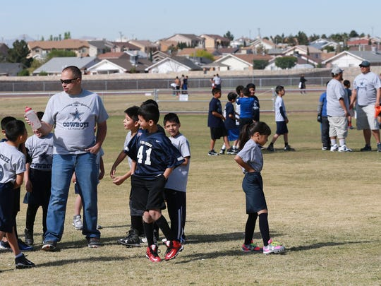 Teams prepare for drills during a flag football practice.