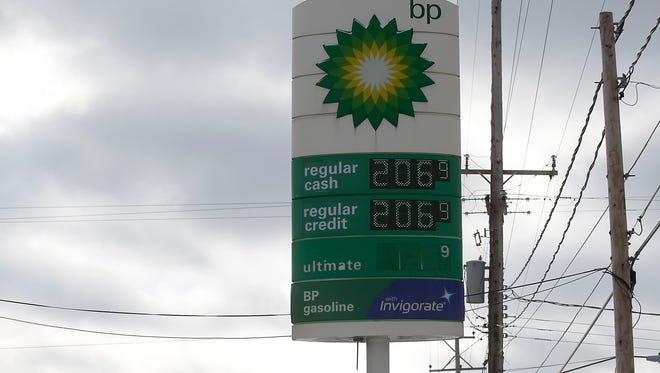 Regular gas cash price is displayed for $2.06 a gallon at a BP station January 6, 2015 in Flint, Michigan.