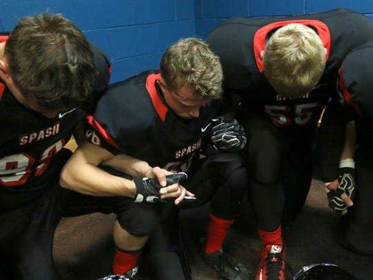 SPASH players together in the locker room before the game between Stevens Point and Wisconsin Rapids at the rivalry Ol' River Jug game, September 23, 2016.