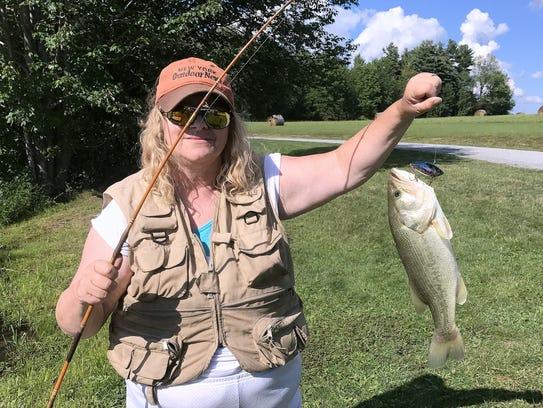 Rain or shine, Carol kept catching bass during our