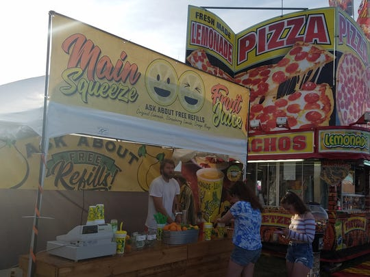 The Main Squeeze Fruit Stand serves freshly squeezed lemonade, dtrawberry lime, and orange mango juice.