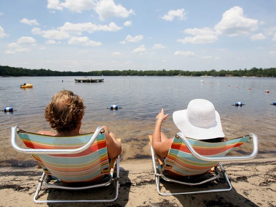 Visitors on Lake Bradford take in the view at the FSU