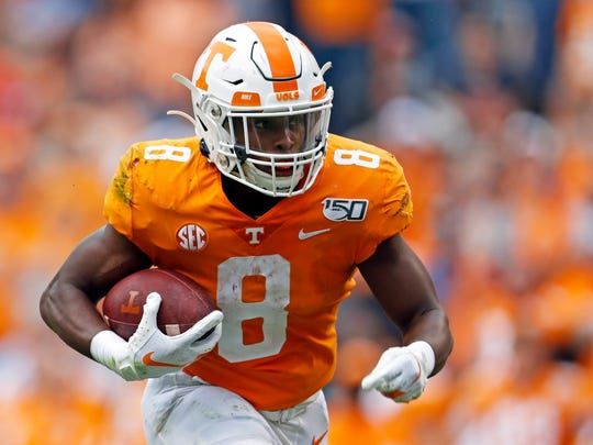 Tennessee running back Ty Chandler (8) runs for yardage in the first half of an NCAA college football game against South Carolina, Saturday, Oct. 26, 2019, in Knoxville, Tenn. (AP Photo/Wade Payne)