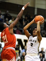 Abilene High's David Russell (2) puts up a shot while