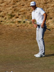 Dustin Johnson misses his eagle putt on the 18th hole