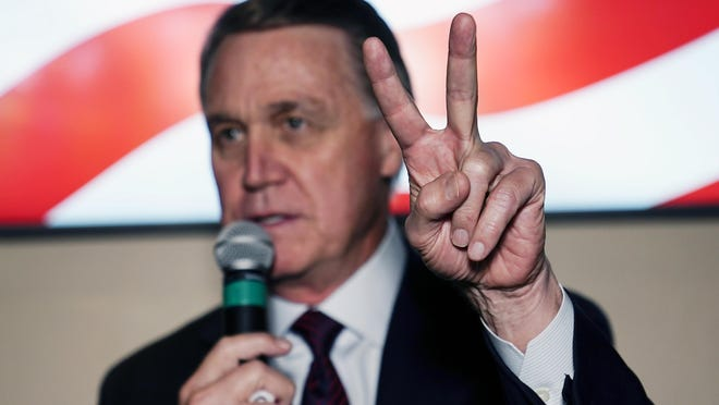 Republican candidate for U.S. Senate Sen. David Perdue speaks during a campaign rally Friday, Nov. 13, 2020, in Cumming.