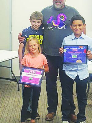 Pratt Public Library Director Eric Killough is pictured with 2019 Junior Librarian of the Year Daniel Rhone, left, 2020 Library Achievement Award recipient Sidney Freeman and 2020 Junior Librarian of the Year Award winner Gabriel Heredia.