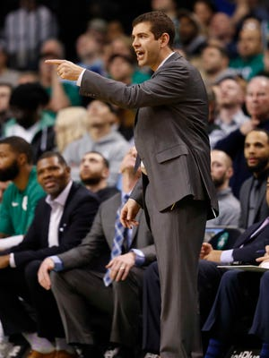 Boston Celtics head coach Brad Stevens reacts on the side line. New Evansville coach Walter McCarty (left) was one of his assistants the past six years.