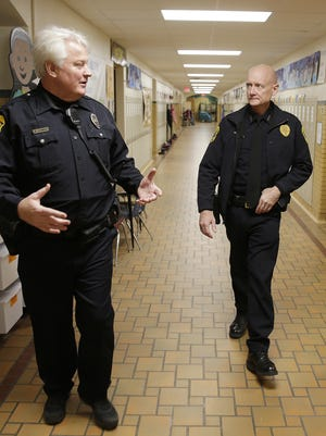 New Green Bay Police Chief Andrew Smith, center, tours Tank Elementary School with Community Resource Officer Dave Schmitz, left, and school staff member Sean Mc Kenzie.