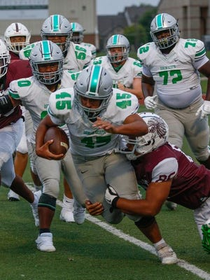 Ed Worthen helped Dublin Scioto rally to defeat Canal Winchester 28-21 on Sept. 11. The Irish play host to Franklin Heights on Friday, Sept. 18.