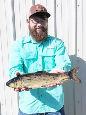 MDC congratulates John Garver of Williamsville for shooting a new state-record spotted sucker. The 3-pound, 6-ounce fish was shot May 1 at Duck Creek Conservation Area north of Puxico.