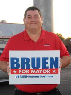 Future Ridgecrest Mayor-elect Eric Bruen poses with a campaign sign as election day winds down Nov. 3, 2020.