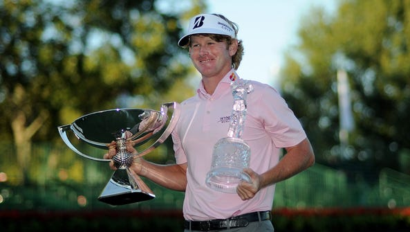 Brandt Snedeker and his trophies for the Tour Championship and the FedExCup from 2012.