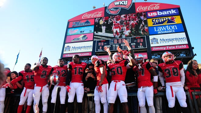 Dec 5, 2015; Bowling Green, KY, USA; Western Kentucky Hilltoppers players celebrate with fans after the Conference USA football championship game against Southern Miss Golden Eagles at Houchens Industries-L.T. Smith Stadium. Western Kentucky Hilltoppers won 45-28. Mandatory Credit: Joshua Lindsey-USA TODAY Sports