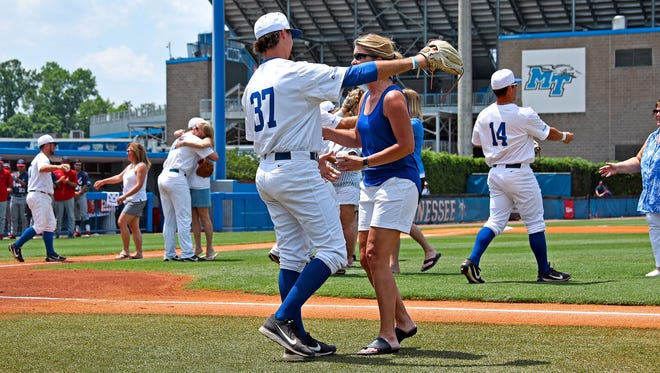 MTSU baseball players hug their mothers on senior day at Reese Smith Jr. Field on May 13, 2018.