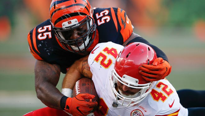 Cincinnati Bengals outside linebacker Vontaze Burfict (55) tackles Kansas City Chiefs fullback Anthony Sherman (42) during the first half of a preseason game Saturday, Aug. 19, 2017, in Cincinnati.
