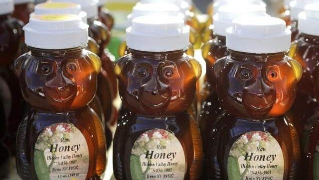 Raw honey for sale at Sparks Hometowne Farmer's Market.