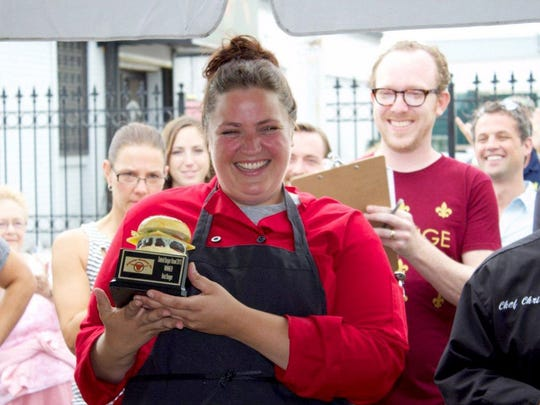 One-Eyed Betty's chef Emmele Herrold, shown holding the 2013 Burger Brawl trophy, will be the chef  for Daily Dinette and Pop's 4 Italian in Ferndale.
