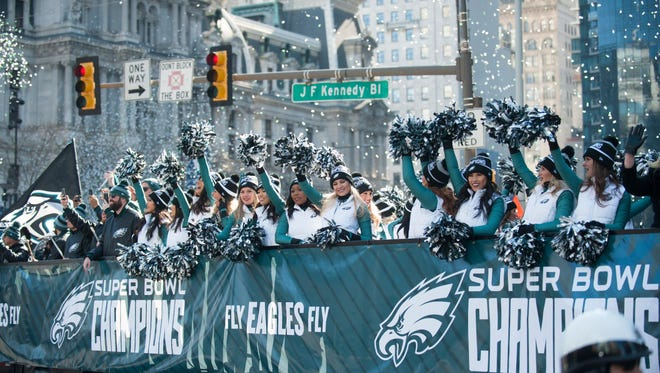 Eagles cheerleaders wave to the crowd as the Philadelphia Eagles Super Bowl LII victory parade turns onto John F. Kennedy Blvd. from 15th Street in Philadelphia earlier this month.