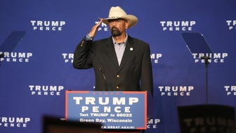 Milwaukee County Sheriff David Clarke Jr. salutes as he takes the podium to warm up the crowd during a rally for Republican presidential nominee Donald Trump at the KI Convention Center in Green Bay last month.