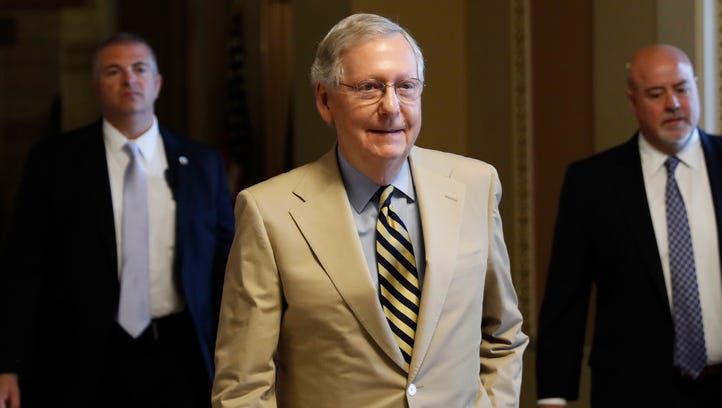 Senate Majority Leader Mitch McConnell walks from his