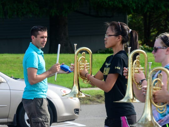 Greg Harris, director of the Vestal Marching Band, leads the team through practice on Tuesday, Sept. 2.