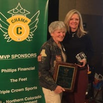 Evelyn Hoeven Arterburn, left, and her daughter, Laura Ecton, won the Keli McGregor and Sonny Lubick awards, respectively, for 2016 Wednesday at the annual CHAMP Breakfast of Champions.