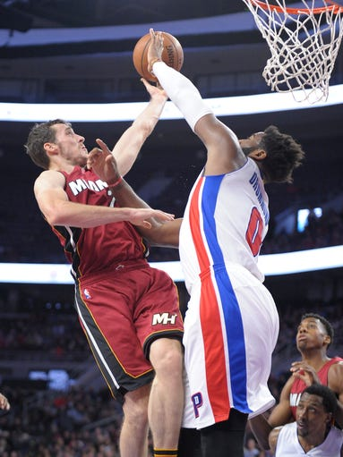 Pistons' Andre Drummond blocks the shot of the Heat's