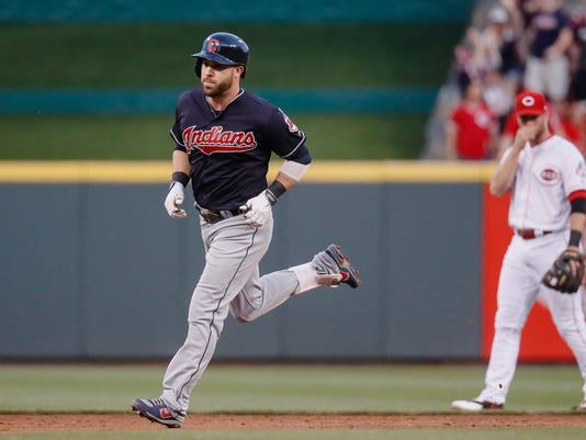Cleveland Indians' Jason Kipnis, left, runs the bases after hitting a solo home run off Cincinnati Reds starting pitcher Scott Feldman (37) in the sixth inning of a baseball game, Monday, May 22, 2017, in Cincinnati. (AP Photo/John Minchillo)