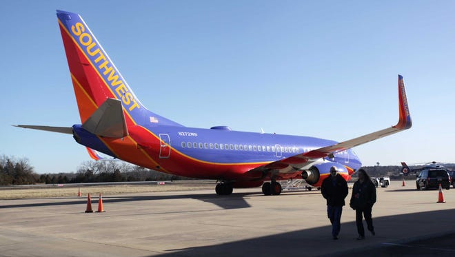 In this Jan. 13, 2014 file photo, Southwest Airlines Flight 4013 sits at the M. Graham Clark Downtown Airport in Hollister, Mo. The plane was supposed to land at the nearby Branson Airport.