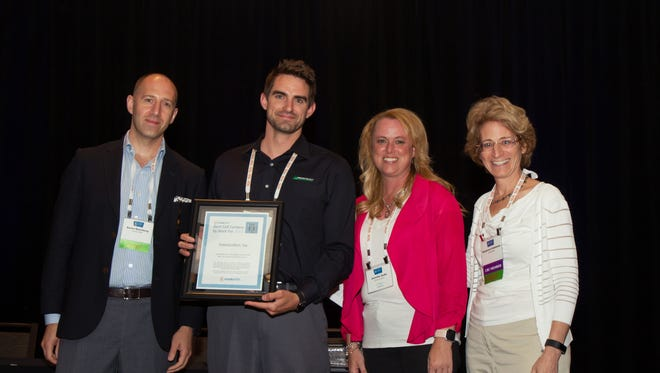 """The Americollect team collects its """"Best Call Center to Work For"""" award."""