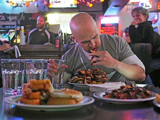 Jeremiah Forster participates in the Dave burger challenge