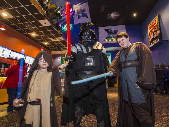 "Benjamin Chase, 7, from left, his father Evan Wissel and Devon DeMarse, Wissel's nephew, all of St. Albans, pose with their costumes before the local premiere of ""Star Wars: The Force Awakens"" at the Essex Cinemas in Essex on Thursday, December 17, 2015."