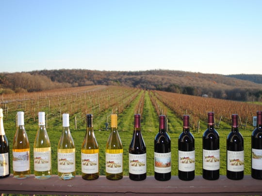Millbrook wines are shown with a view of the vineyard.