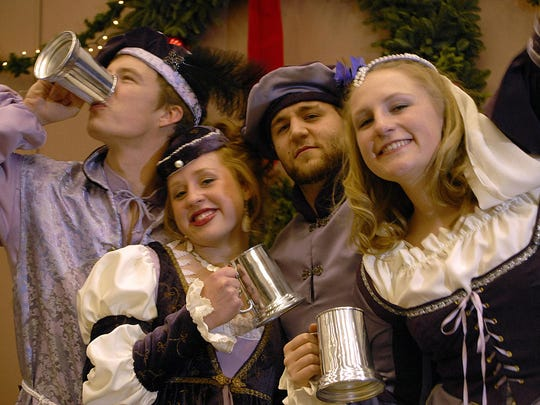 Well-dressed lords and ladies revel at the 2007 Madrigal Dinner. The 2015 dinner takes place Dec. 3.