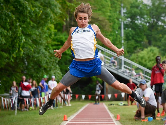 St. Cloud Cathedral's Cole Tetrault sails into the pit in the triple jump during the Section 5A track and field championsips Wednesday, May 30, at St. John's University in Collegeville.