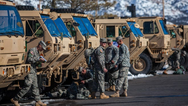 Soldiers with the 213th Forward Support Company get settled at the Utah National Guard Armory in Cedar City for Operation Seismos, Friday, Feb. 6, 2016. Iron County announced the release of an app that will help residents in the case of a disaster.