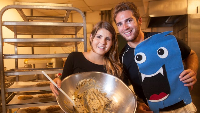 Rowan graduates Cassie Aran and Brandon Lucante launched Cookie Munchers, an on-demand freshly homemade cookie delivery service for Rowan students living on and off campus and Glassboro residents. Lucante is holding the Cookie Munchers mascot.