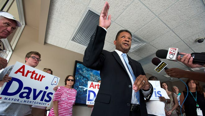 Artur Davis talks with the media and supporters after he turns in his qualifying paperwork to run for Mayor of Montgomery on Tuesday July 7, 2015 in downtown Montgomery, Ala.