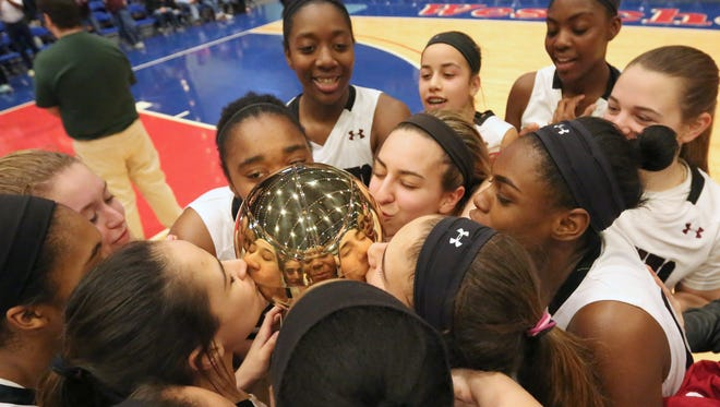 Ossining players celebrate after beating North Rockland 77-60 to win the Class AA final at the Westchester County Center Feb. 28, 2016. Ossining won 77-60.