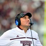 Nov 14, 2015; Starkville, MS, USA; Mississippi State Bulldogs head coach Dan Mullen watches a replay during the second quarter of the game against the Alabama Crimson Tide at Davis Wade Stadium. Mandatory Credit: Matt Bush-USA TODAY Sports