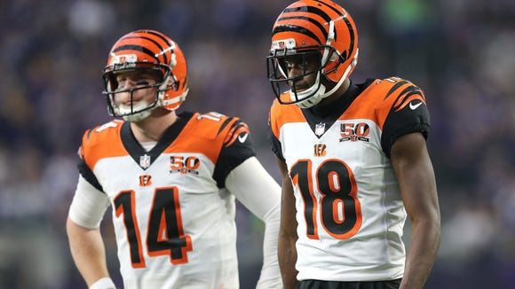 Cincinnati Bengals quarterback Andy Dalton (14), left, and Cincinnati Bengals wide receiver A.J. Green (18) reacts to an incomplete pass play in the third quarter during the Week 15 NFL game between the Cincinnati Bengals and the Minnesota Vikings, Sunday, Dec. 17, 2017, at U.S. Bank Stadium in Minneapolis, Minnesota.