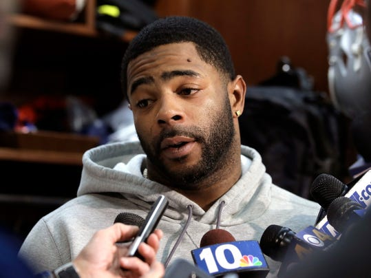 FILE - In this Jan. 25, 2018, file photo, New England Patriots cornerback Malcolm Butler takes questions from reporters in the team's locker room following NFL football practice in Foxborough, Mass. Butler said Tuesday, Feb. 6, 2018, that he didn't miss a curfew or do anything off the field that would have hurt New England's chances of winning the Super Bowl before he was benched for the game. (AP Photo/Steven Senne, File)