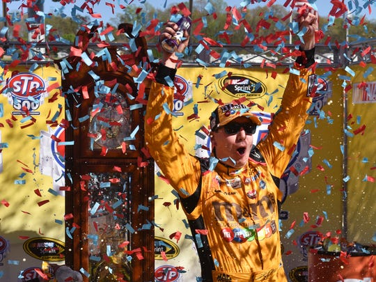 Kyle Busch celebrates after winning the Alpha Energy Solutions 250 at Martinsville Speedway.