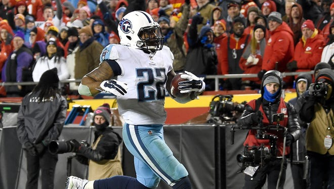 Titans running back Derrick Henry (22) scores during the second half Saturday.