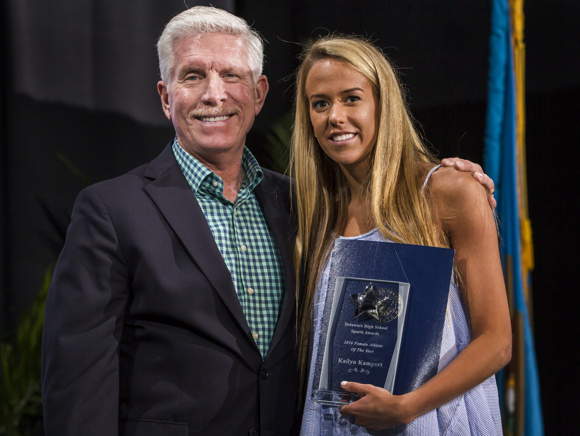 Ursuline's Kailyn Kampert poses with Mike Schmidt after being named the female athlete of the year at the Delaware Sports Awards banquet at the Bob Carpenter Center at the University of Delaware in Newark on Wednesday evening.
