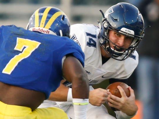Delaware defensive back Ray Jones moves in on Villanova quarterback Zach Bednarczyk in the second quarter at Delaware Stadium in 2016