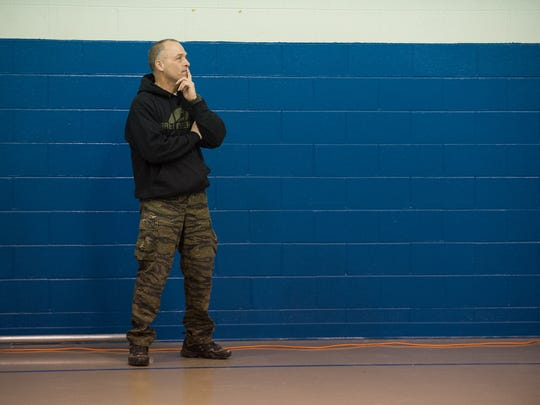 Dover Police Master Cpl. Keith Hester watches a youth basketball game at Fort A.B.L.E. in Dover.