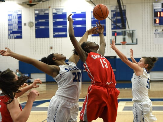 Canton Chief Shamya Butler, center, goes airborne for